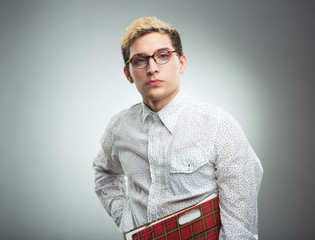 Young serious man looking to the camera wearing glasses