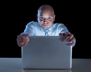 businessman at night at computer watching porn online gambling
