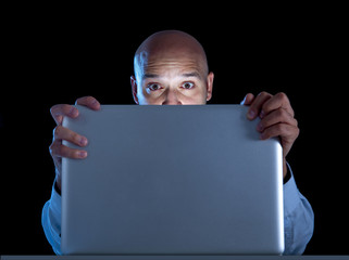 businessman at computer watching porn or online gambling