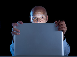 businessman late night at computer laptop online porn addict