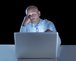 businessman working on computer laptop late night falling asleep