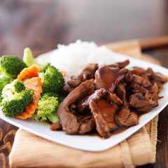 japanese chicken teriyaki with rice and vegetables on wood table