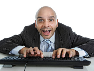 businessman typing on computer keyboard funny face