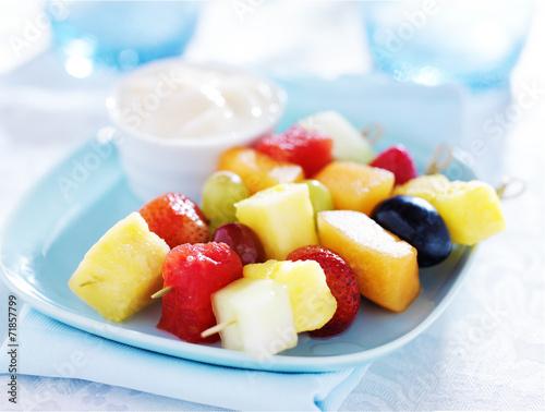 Fotobehang Vruchten children's fruit kabob with vanilla yogurt dip on blue plate