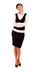Businesswoman standing with folded arms, white background