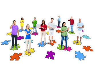Diverse People Using Digital Devices with Jigsaw Pieces