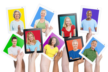 Multi-Ethnic Casual People Holding Tablets