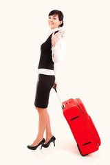 Businesswoman with big, red suitcase, traveling