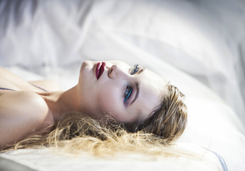 Blonde woman lying