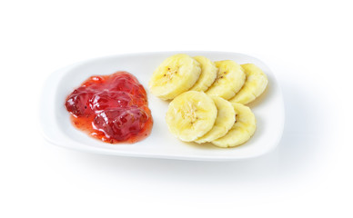 Banana slices with Strawberry Jam isolated