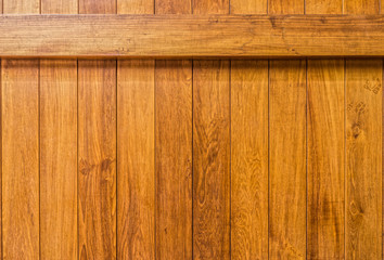 Wooden wall with beam constructed from teak wood lumber planks