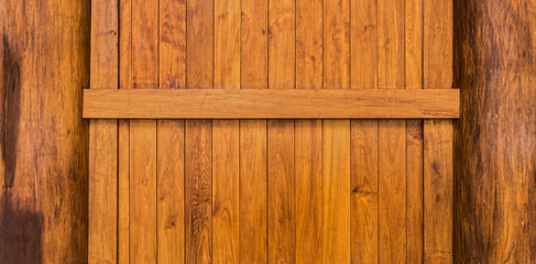 Wooden wall with beam and columns constructed from teak wood