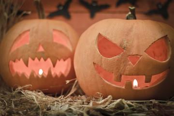 Two different Halloween pumpkins on autumn background