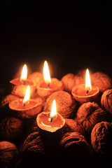 candle from the walnut shells - christmas tradition