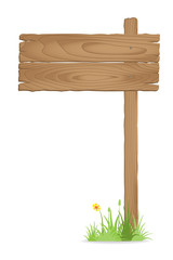 Wooden signpost on  grass with flower
