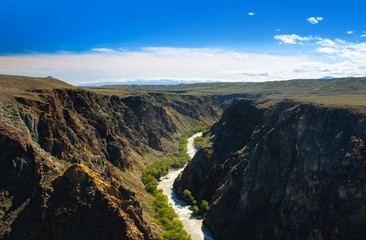 Beautiful river in Charyn canyon and blue sky with clouds
