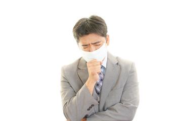 風邪に罹患したビジネスマン
