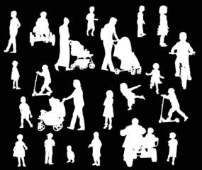parents and children silhouettes isolated on black