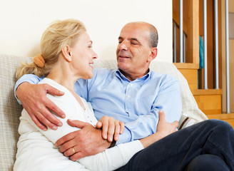 mature woman with senior husband in home