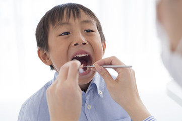 Boy undergoing dental caries check