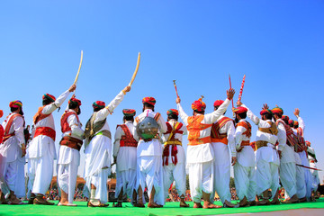 Indian men in traditional dress taking part in Mr Desert competi