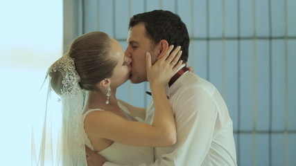 Happy groom kissing beautiful bride