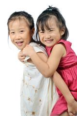 Asian little girl carries her sister on her back