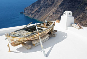 Old boat on the roof at Santorini Island, Greece