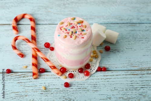 Leinwandbild Motiv Cranberry milk dessert in glass and glass jar,