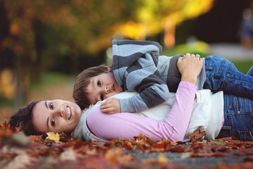 Young mom with her little boy in the park