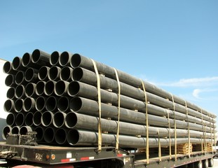 Load of black PVC pipes