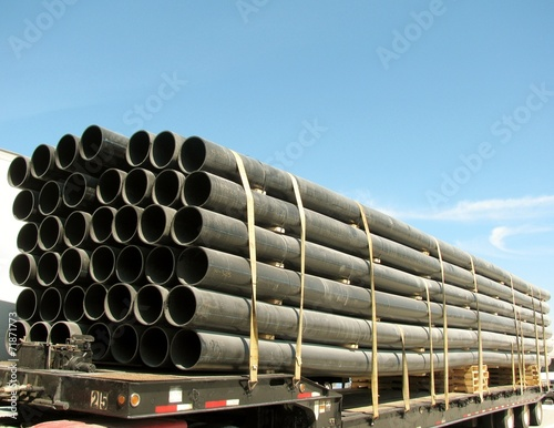 Load of black PVC pipes Poster