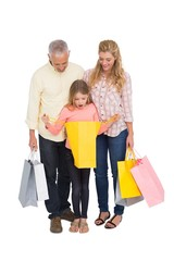 Parents and daughter with shopping bags
