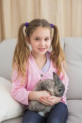 Cute little girl with her pet bunny