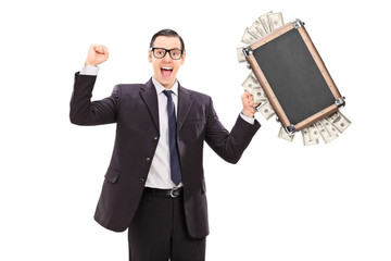 Excited businessman holding a bag full of money