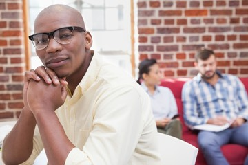 Hipster businessman looking at camera