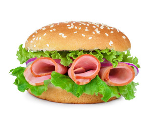 ham, lettuce, onions on a sandwich with sesame seeds isolated on