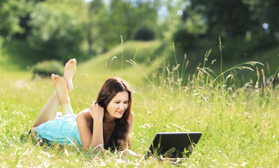 Beauty girl with laptop outdoors