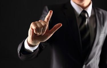 Businessman hand pressing