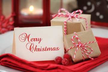 Christmas greeting card with copyspace on a plate with gifts