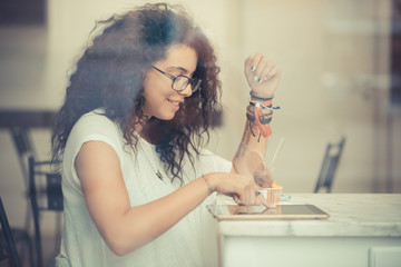 young beautiful moroccan curly woman using tablet