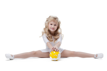Image of pretty little gymnast posing on split