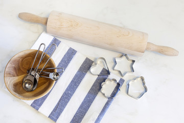 Baking tools with cookie cutters and measuring spoons
