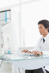 Serious doctor using the computer