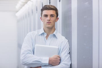Portrait of a confident technician holding a laptop