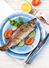 River trout with fresh tomatoes, lemon and herbs