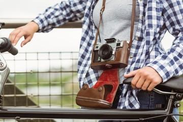 Close up of a retro camera around the neck of the girl