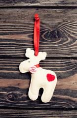 christmas deer on wooden background