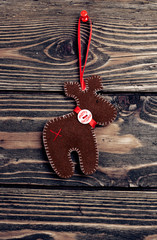 christmas deer on wooden background