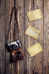 Old retro camera and blank instant photo frames
